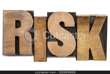 risk word in letterpress wood type stock photo, risk - isolated word in vintage letterpress wood type by Marek Uliasz