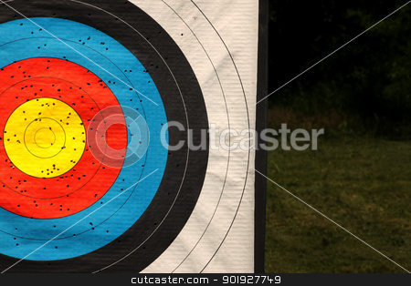 Target stock photo, Used archery target on position on archery range by vaximilian