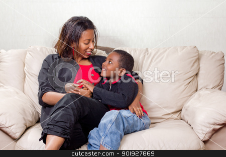 Loving mother with her son stock photo, Loving mother and son looking into eachother's eyes by derejeb