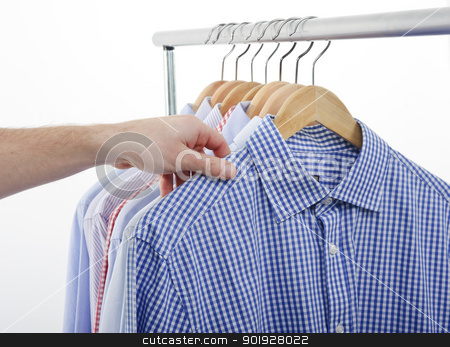 hand shirt choose stock photo, man choosing and taking his shirt by tommaso79