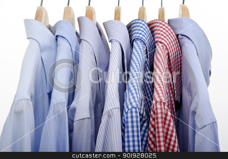 lot of shirts stock photo, lot of shirts hanging on white background by tommaso79