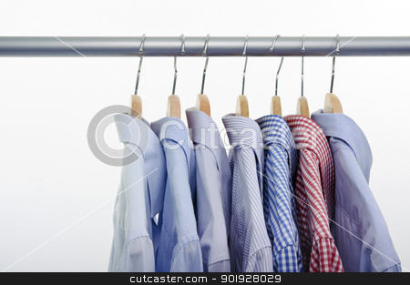 shirts isolated stock photo, shirts isolated on white background and hanger by tommaso79