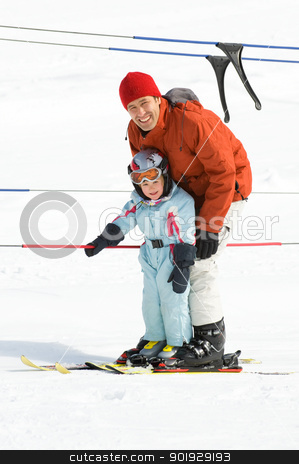 Family skiing stock photo, Father with his daughter in the ski lift by Picturehunter