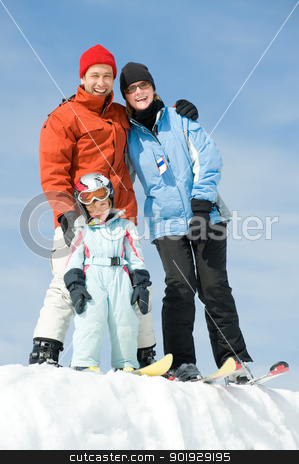 Happy family stock photo, Young family with ski in front of blue sky by Picturehunter