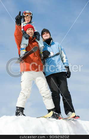 Family skiing stock photo, Young family with ski in front of blue sky by Picturehunter