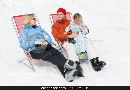 Family in the winter stock photo, Happy young family with ski boots sitting in chairs by Picturehunter