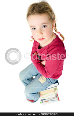 Girl with books stock photo, Full isolated studio picture from a young child sitting on some books by Picturehunter