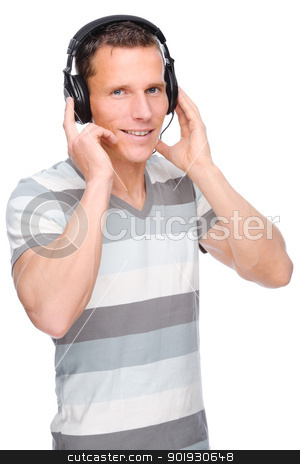 Listen to the music stock photo, Full isolated studio picture from a young man with headphone by Picturehunter