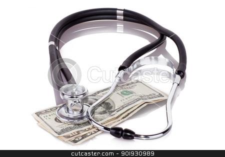 stethoscope on dollars stock photo, stethoscope placing on US dollar banknotes on white background by georgenightingale