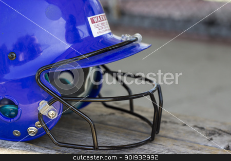 Blue Batting Cage Helmet stock photo, A blue batting cage helmet sitting on a bench by Jadthree