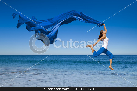Jumping stock photo, Beautiful young woman jumping on the beach with a colored tissue  by ikostudio