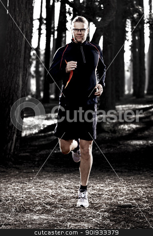 Runing in the forest stock photo, Athletic man doing exercise, running in the forest by ikostudio