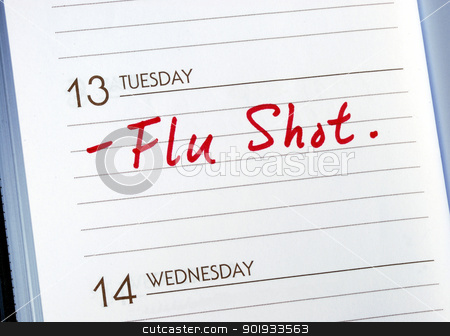 Mark the date on the day planner to have a flu shot stock photo, Mark the date on the day planner to have a flu shot by johnkwan