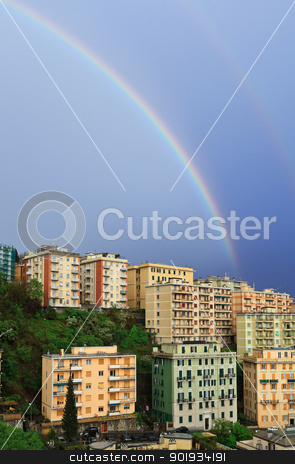 rainbow over the town stock photo, wonderful rainbow after a storm in Genoa, Italy by ANTONIO SCARPI