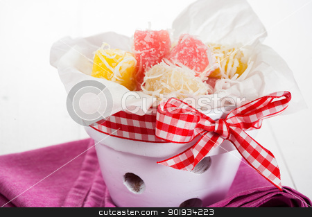 coconut ice candy stock photo, Close up of white yellow and pink coconut ice confectionery with fresh coconuts isolated on white by p.studio66