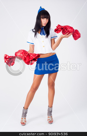 Young beautiful air hostess stock photo, Attractive young stewardess with big candies at white background by Aikon
