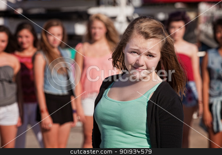 Cute Female Teenager stock photo, Young cute teen female in front of group of girls by Scott Griessel