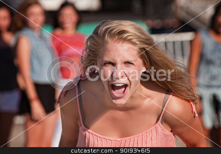 Screaming Teenage Girl stock photo, Upset screaming young white teenager with group by Scott Griessel