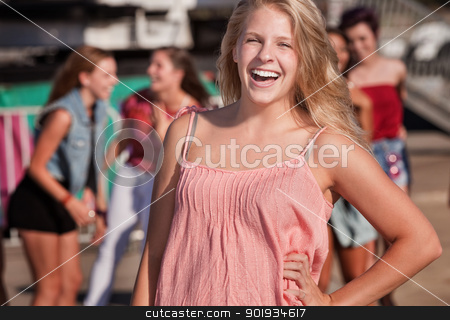 Blond Teenage Girl Laughing stock photo, Cute Caucasian teenager with hand on hip laughing by Scott Griessel