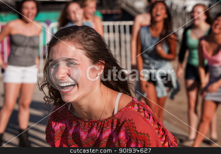 Laughing Teenage Female stock photo, Laughing European teenager at carnival with friends by Scott Griessel