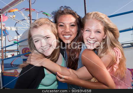 Three Best Friends Together stock photo, Group of three Asian and white teenage girlfriends at a carnival by Scott Griessel