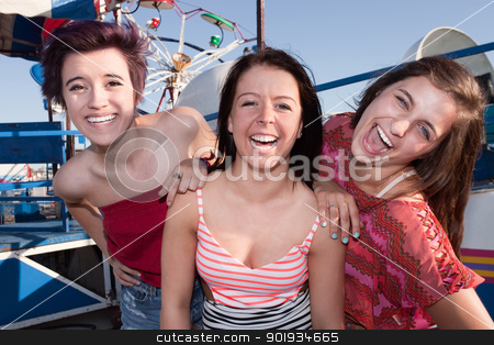 Happy Girls at an Amusement Park stock photo, Group of three pretty teenage girlfriends at an amusement park by Scott Griessel