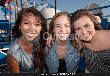 Best Friends Hanging Out Together stock photo, Group of three cheerful teenage girls embracing each other by Scott Griessel