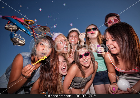 Teen Girls Blowing Bubbles stock photo, Diverse group of teen girls at carnival blowing bubbles by Scott Griessel