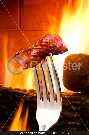 Steak. stock photo, Steak on a silver fork. by WScott