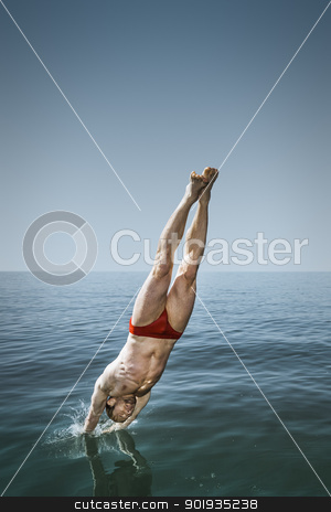 man jumping in the lake stock photo, An image of a handsome man jumping in the lake by Markus Gann