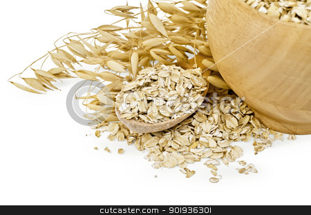 Oat flakes in a bowl and spoon stock photo, Oat flakes in a wooden bowl and spoon, stalks of oats isolated on white background by rezkrr