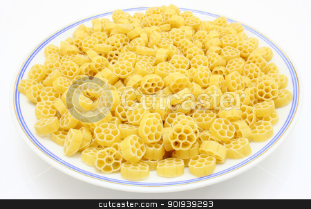 Yellow pasta  stock photo, Yellow pasta in the form of wheels on a white background a structure by aarrows