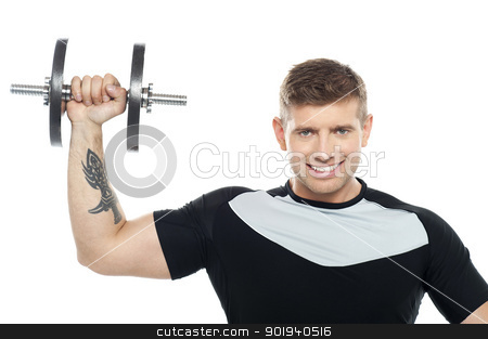 Male instructor posing with raised dumbbell stock photo, Half length portrait of young male instructor posing with raised dumbbell by Ishay Botbol