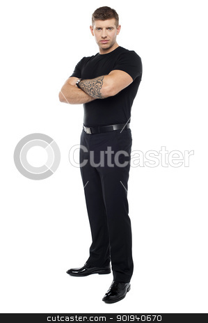 Bouncer with tattoo on hand posing with arms crossed stock photo, Bouncer with tattoo on hand posing with arms crossed isolated against white background by Ishay Botbol