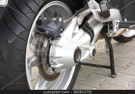 Wheel of motorcycle stock photo, Black wheel of a motorcycle with the chromeplated muffler the rear view by aarrows