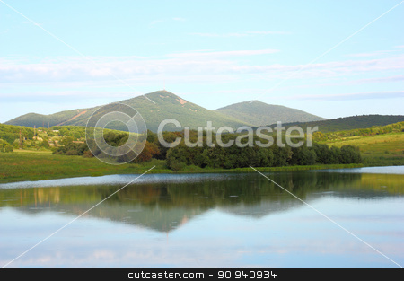 Mountain lake stock photo, Landscape mountain lake against the sky in clouds by aarrows