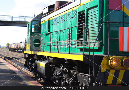 Locomotive green with yellow stripe stock photo, Locomotive green with yellow stripe by aarrows