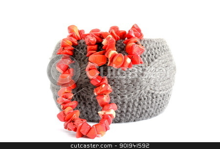 bracelet and coral beads stock photo, crocheted gray bracelet and red coral beads over white by coroiu octavian