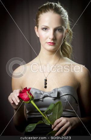 girl with rose stock photo, Attractive woman holding a rose on Valentine's day, by Peter Mikuska