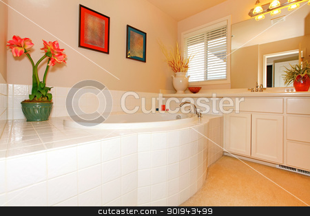 Bathroom with large round white tub and cabinets with  double sink. stock photo, Bathroom with large round white tub and cabinets with  double sink. by iriana88w