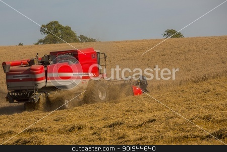Beating the Weather 3 stock photo, Farmer and Combined Harvester processing a wheat field in West Somerset, England. by Trevor Jordan