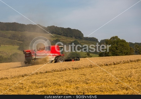 Beating the Weather 5 stock photo, Farmer and Combined Harvester processing a wheat field in West Somerset, England. by Trevor Jordan