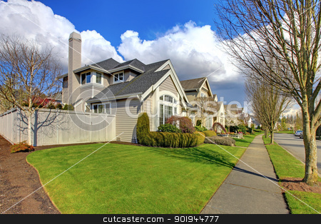 Classic American house and street with fence in the spring. stock photo, Classic American house in NorthWest and street with fence in the spring. by iriana88w