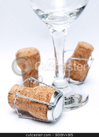 Champagne utensils stock photo, Champagne corks and one glass on a white background. by Sinisa Botas