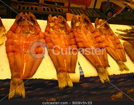 The dried and cut marine fish is on sale stock photo, The dried marine fish is on sale in the market by Alexander Matvienko