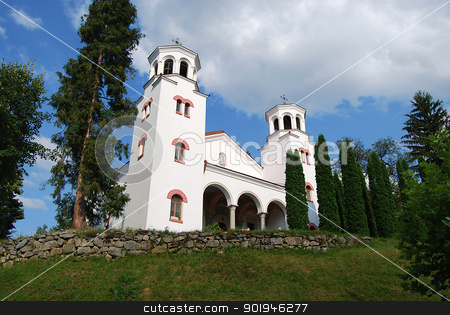 White church on hill stock photo, White church on hill, yew trees on blue sky background by Aleksandar Varbenov