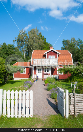 Red painted Swedish house stock photo, Traditional red painted wooden Swedish house in a lush green garden with a white picket fence and open gate with a walkway leading to the front door by Kai Schirmer