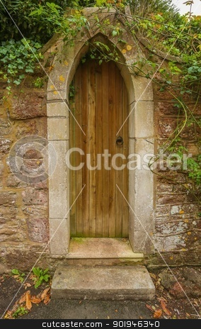 Gothic Arched Garden Entrance Doorway stock photo, A Gothic Arched Garden Entrance Doorway leading off of the street into a private and secluded garden. by Trevor Jordan