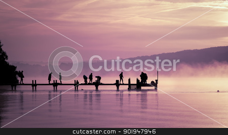 early sport stock photo, An old jetty with peolpe doing early sport by Markus Gann