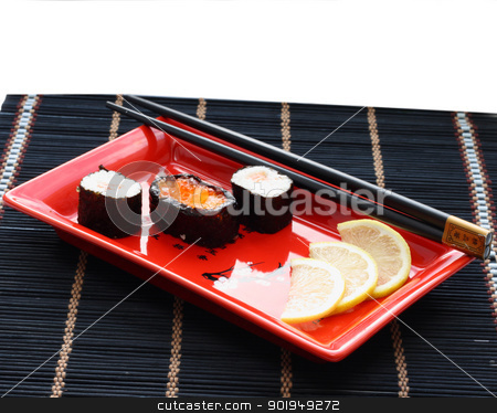 Sushi stock photo, Sushi roll with black chopsticks on red plate isolated on white background by Oleksandr Pakhay